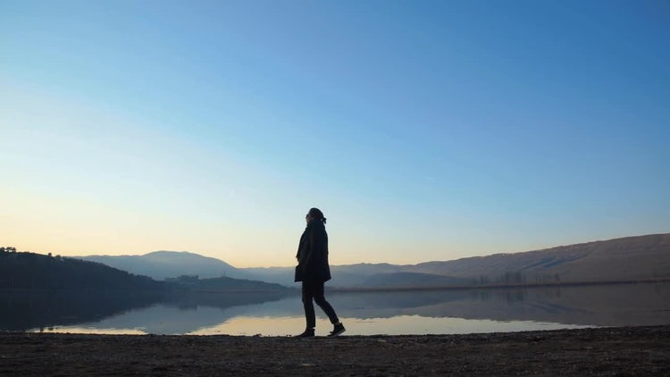 Woman Near The Lake: Stock Video