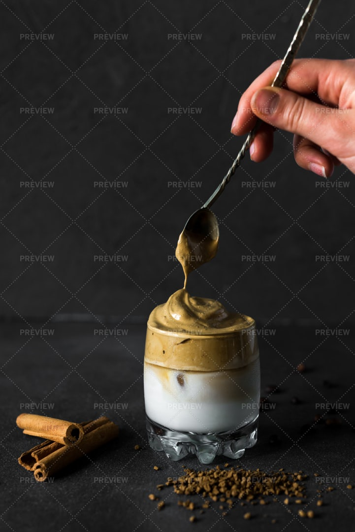Spooning Coffee Into A Glass: Stock Photos