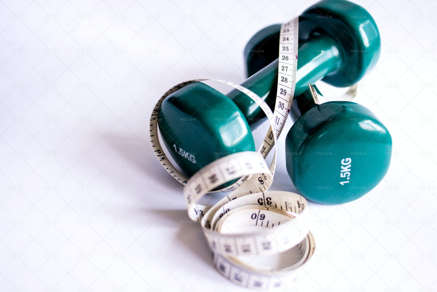 Dumbbells And Measuring Tape: Stock Photos
