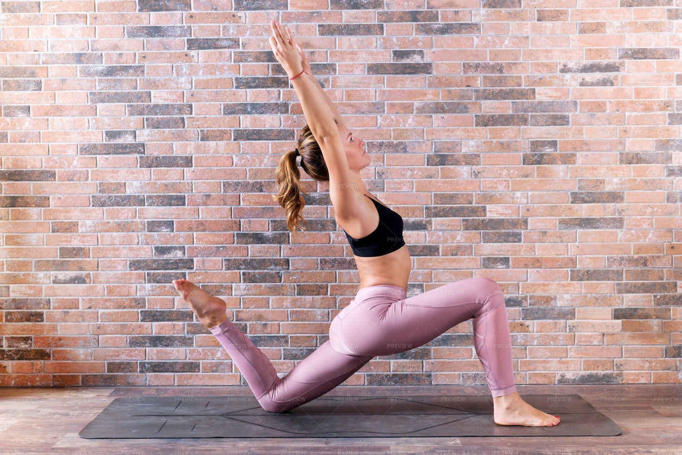 Woman Performs A Low Lunge: Stock Photos