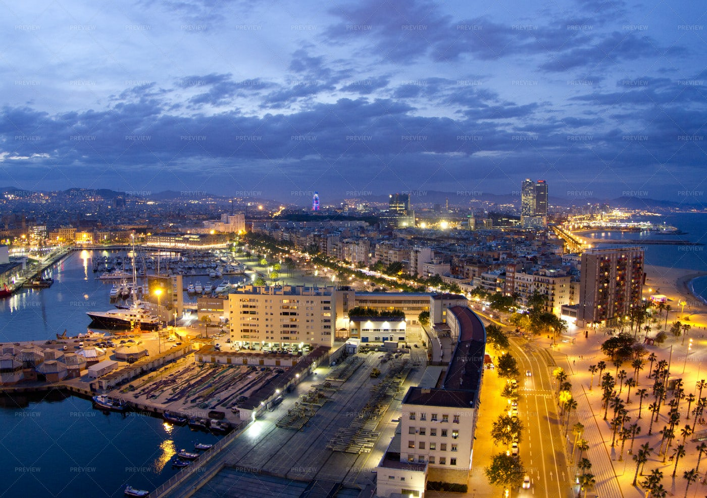 Barcelona Skyline At Night: Stock Photos