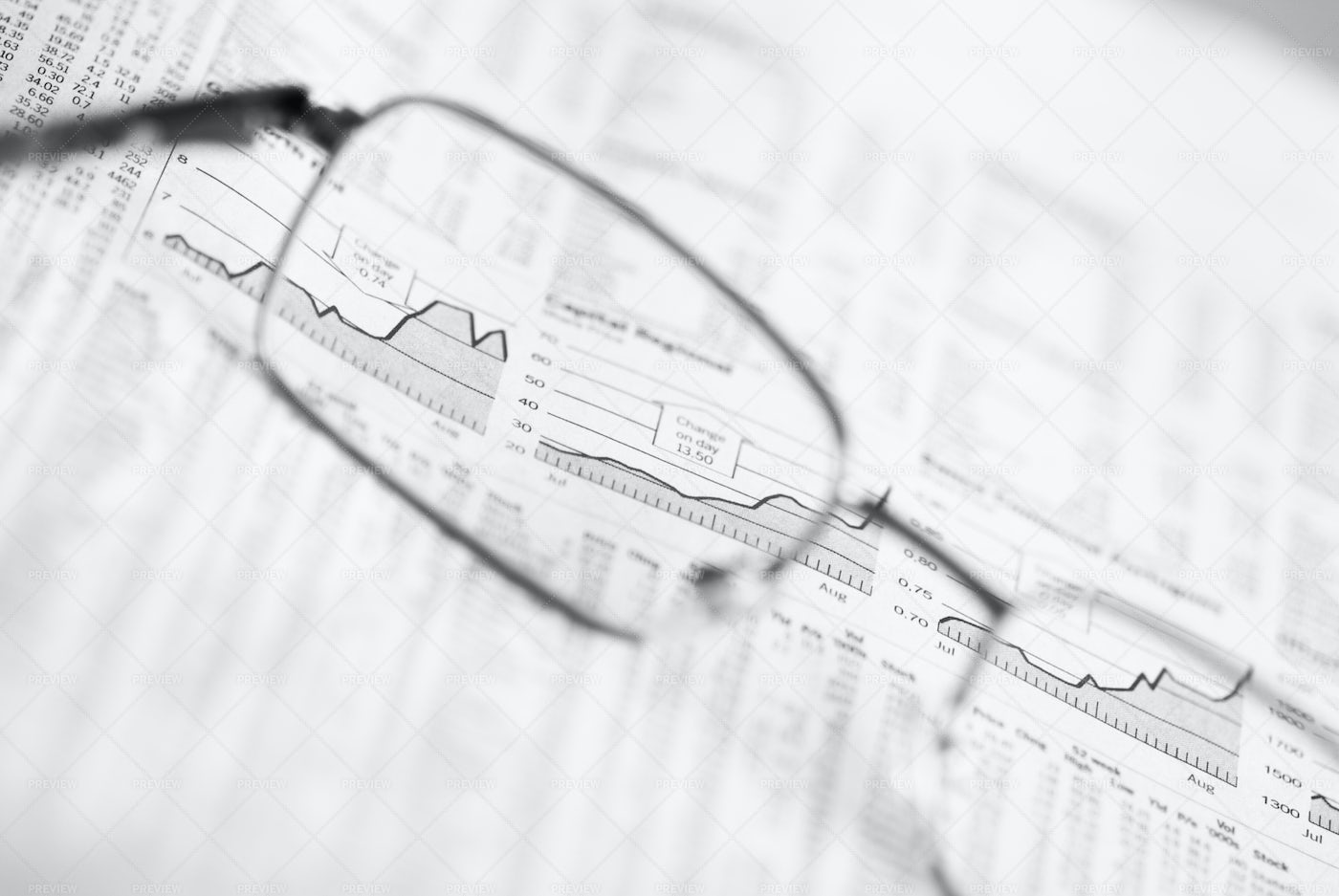Glasses On Financial Chart: Stock Photos
