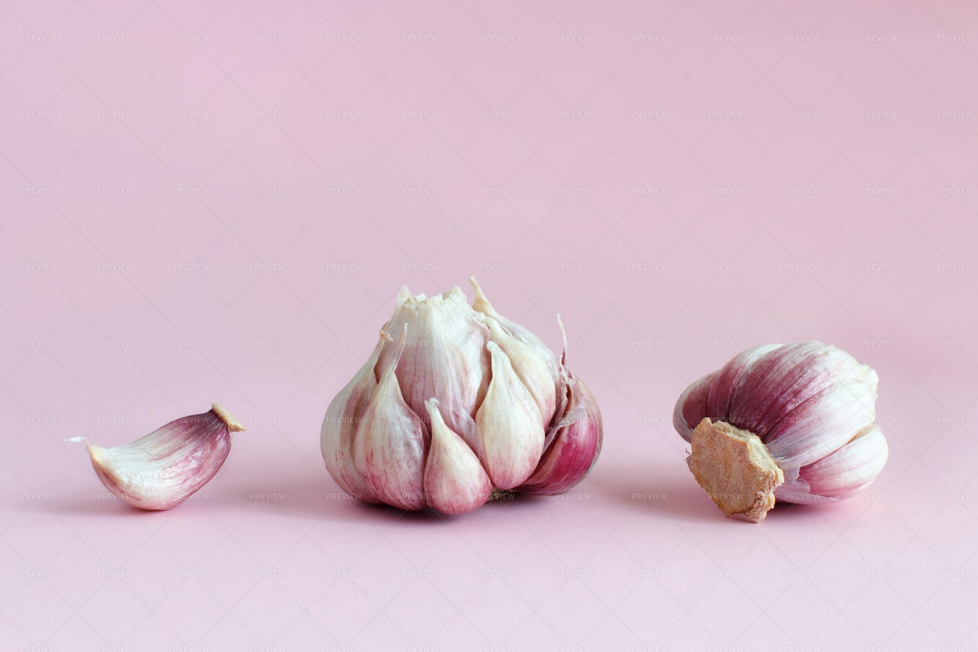 Fresh Garlic Against Pink: Stock Photos