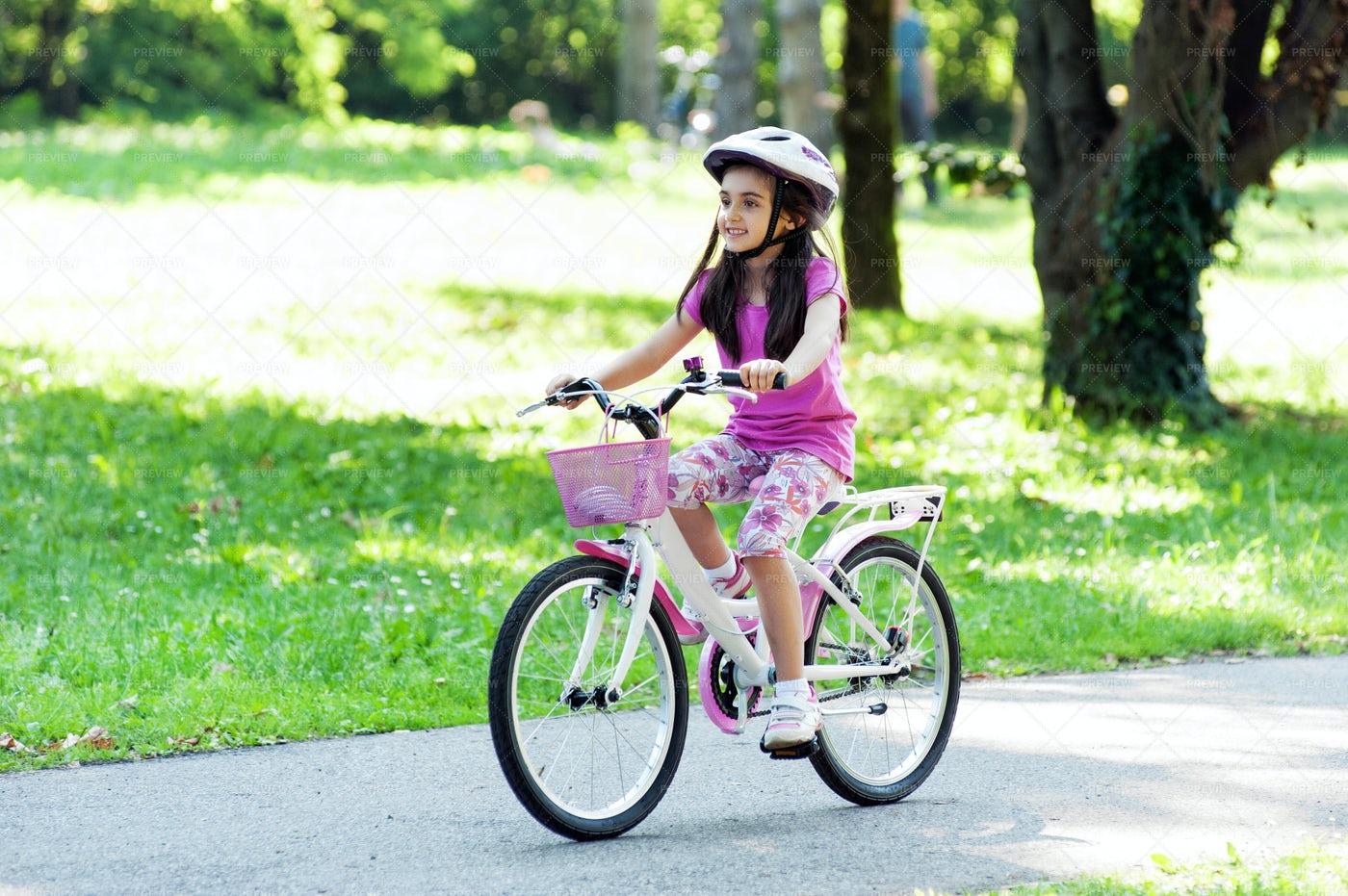 Girl Riding Her Bicycle: Stock Photos