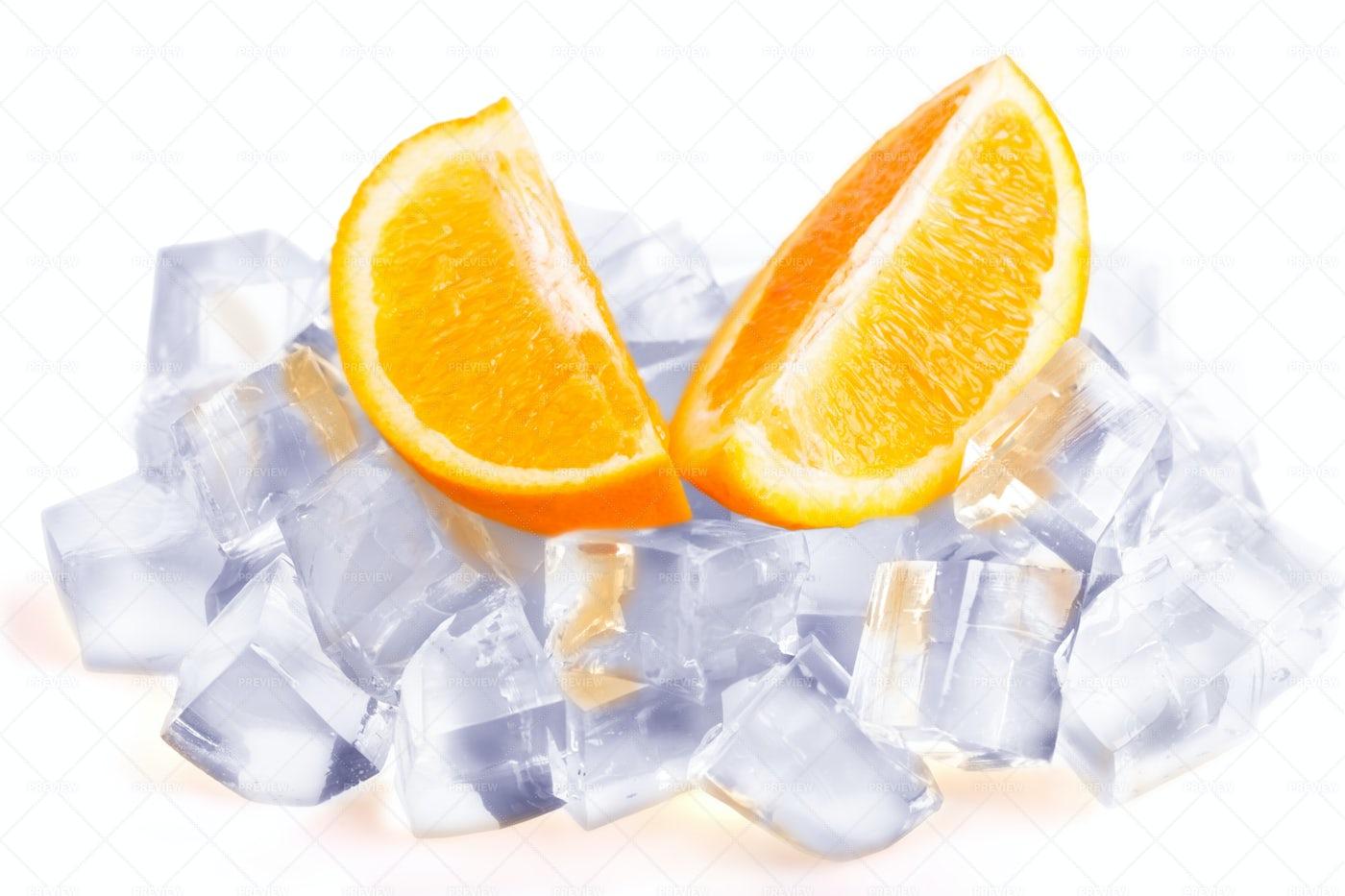 Two Orange Slices With Ice: Stock Photos