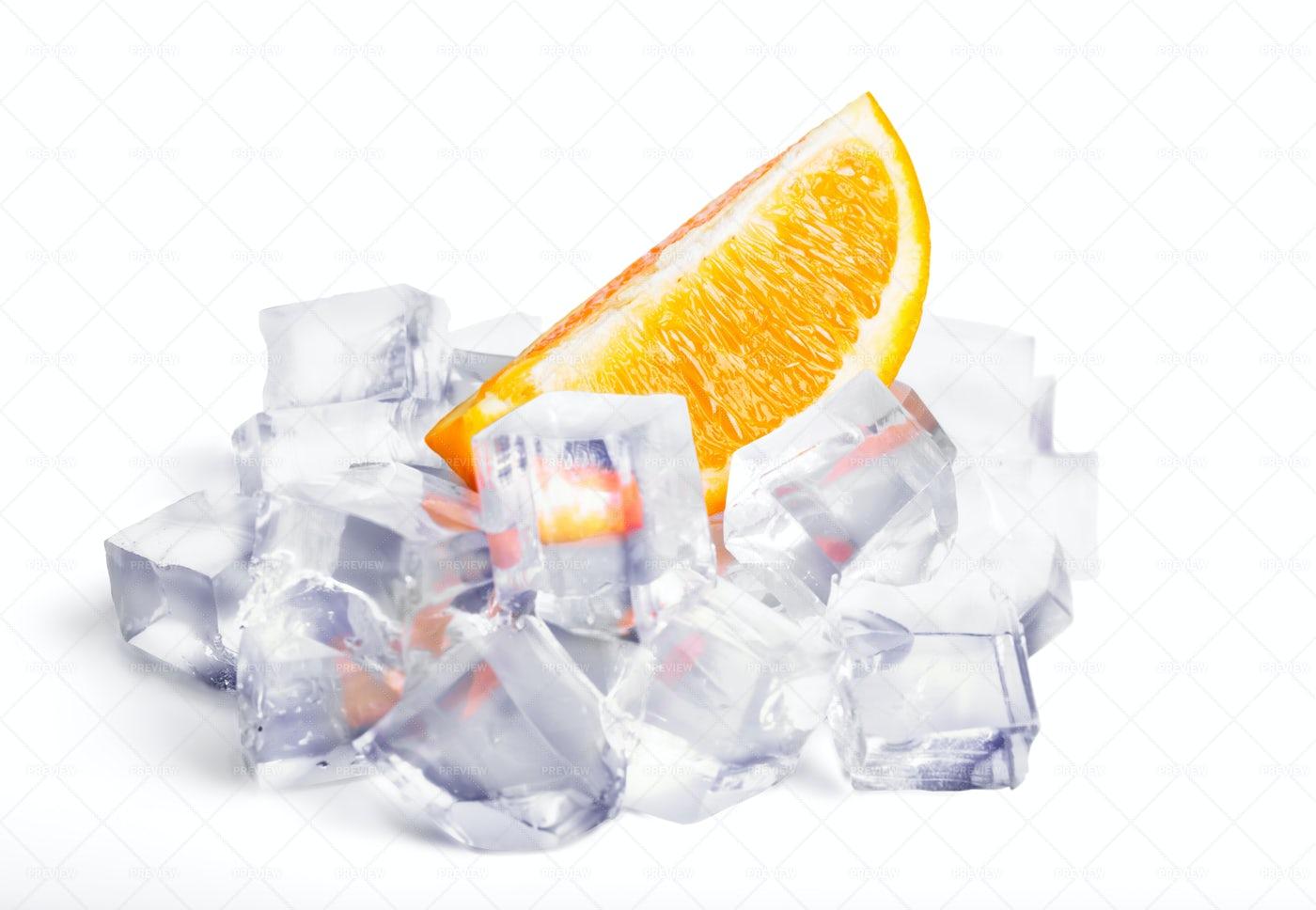 Orange Slice In Ice: Stock Photos