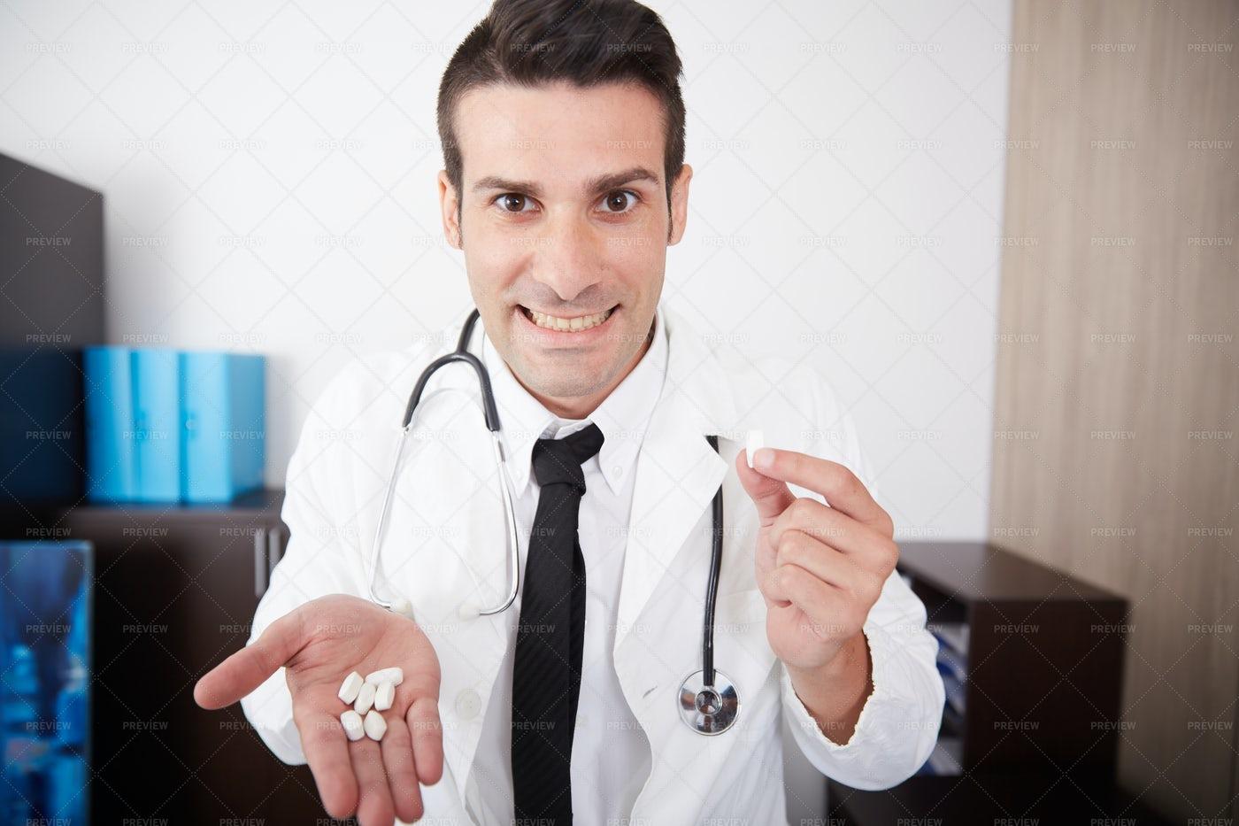 Doctor's Handful Of Pills: Stock Photos