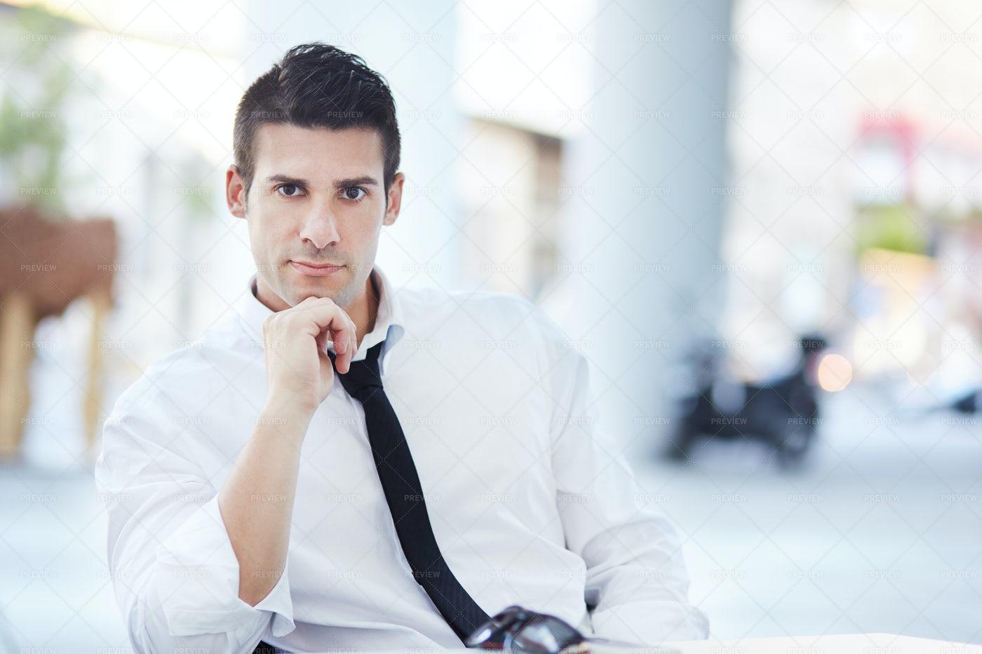 Businessman Takes A Seat: Stock Photos