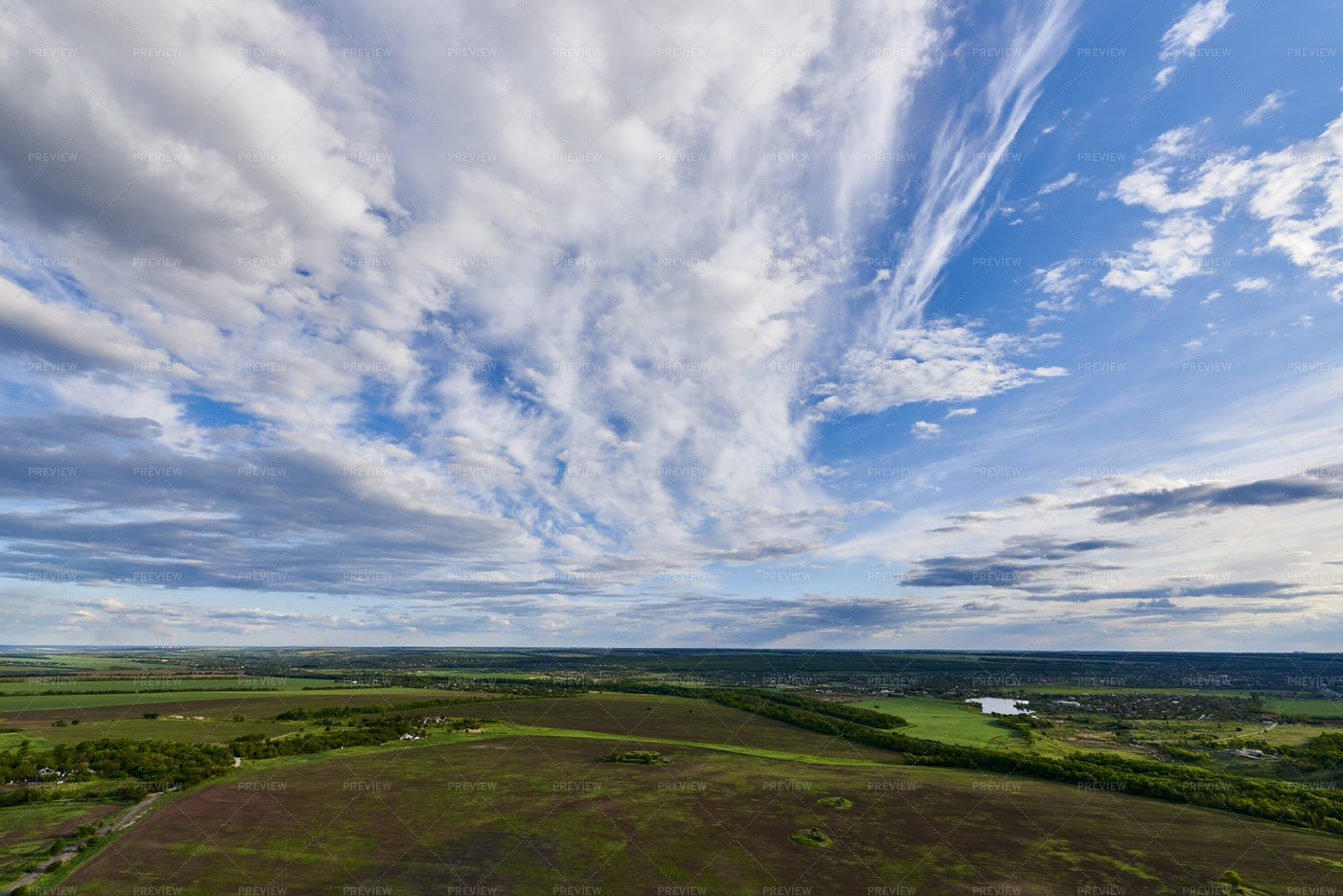 Clouds Over Vast Fields: Stock Photos