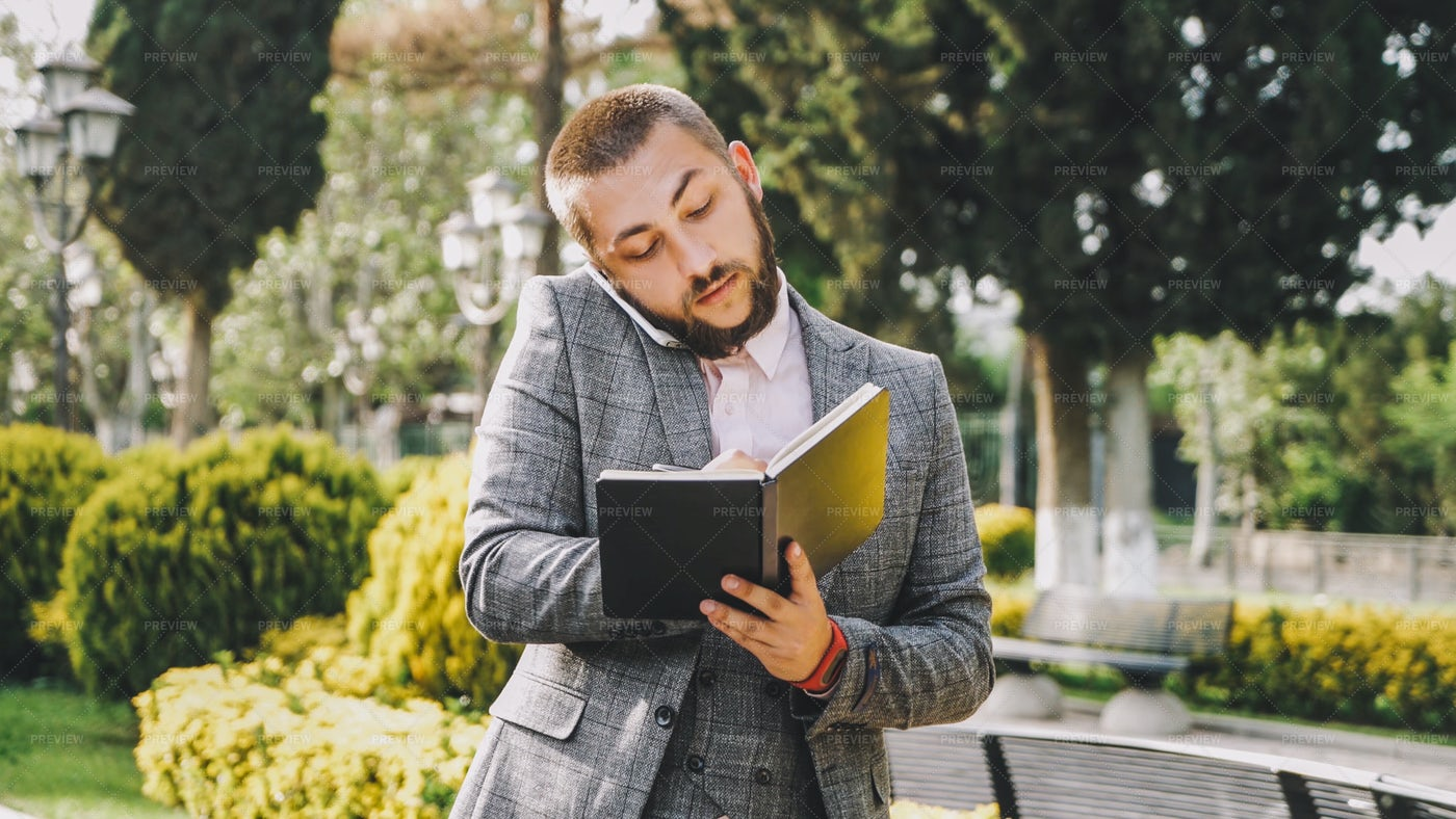 Taking Notes On A Call: Stock Photos