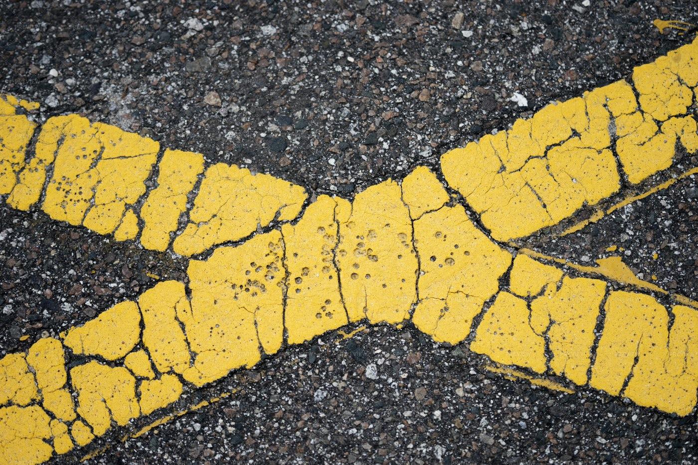 Yellow Cross On Asphalt: Stock Photos