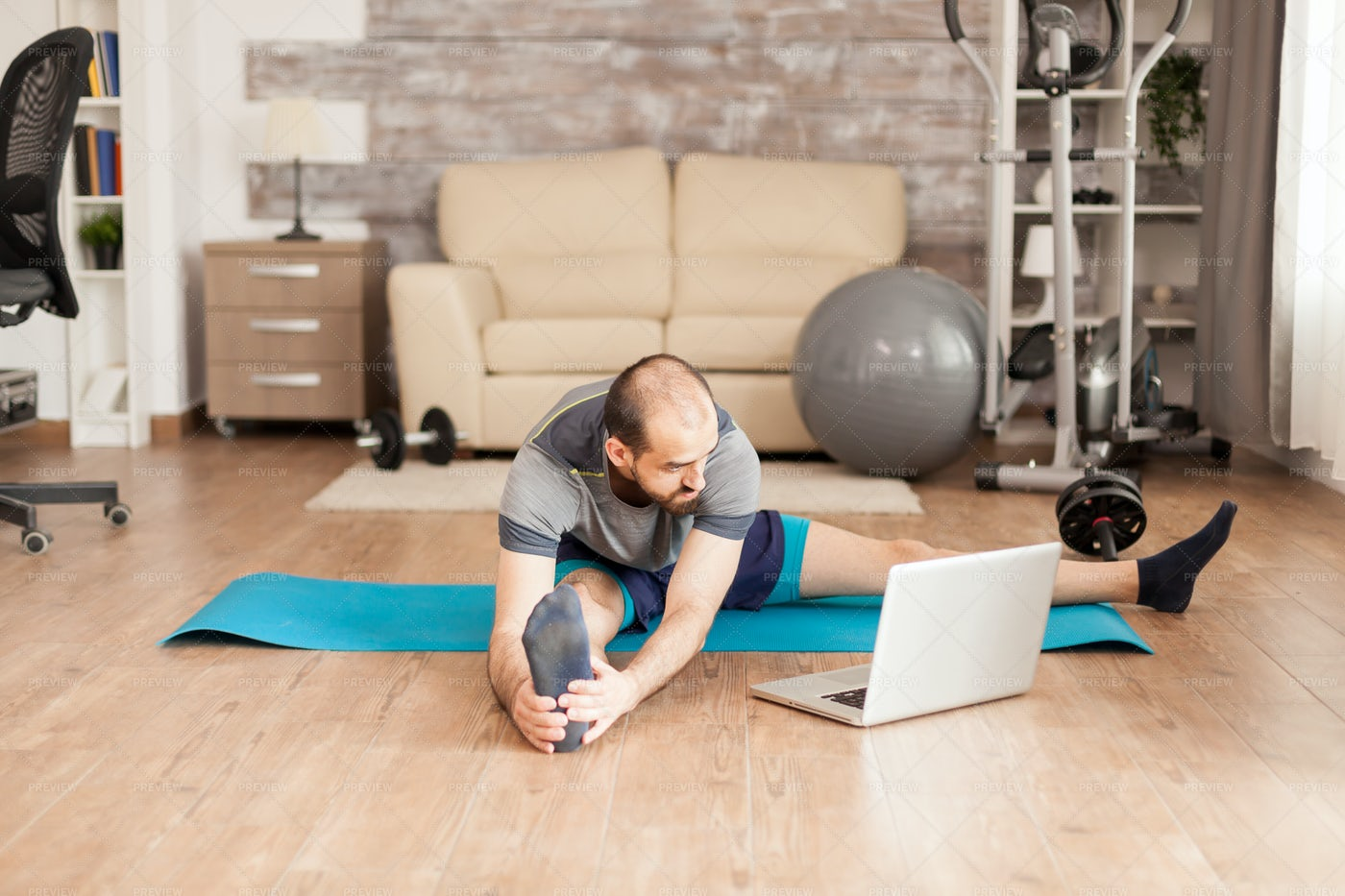 Following A Yoga Tutorial: Stock Photos