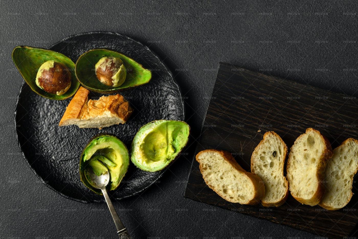 Avocado Halves And Bread: Stock Photos