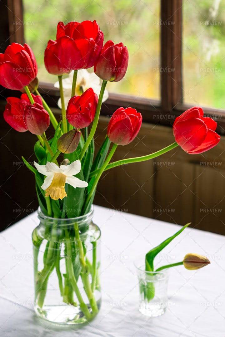 Red Tulips In A Jar: Stock Photos