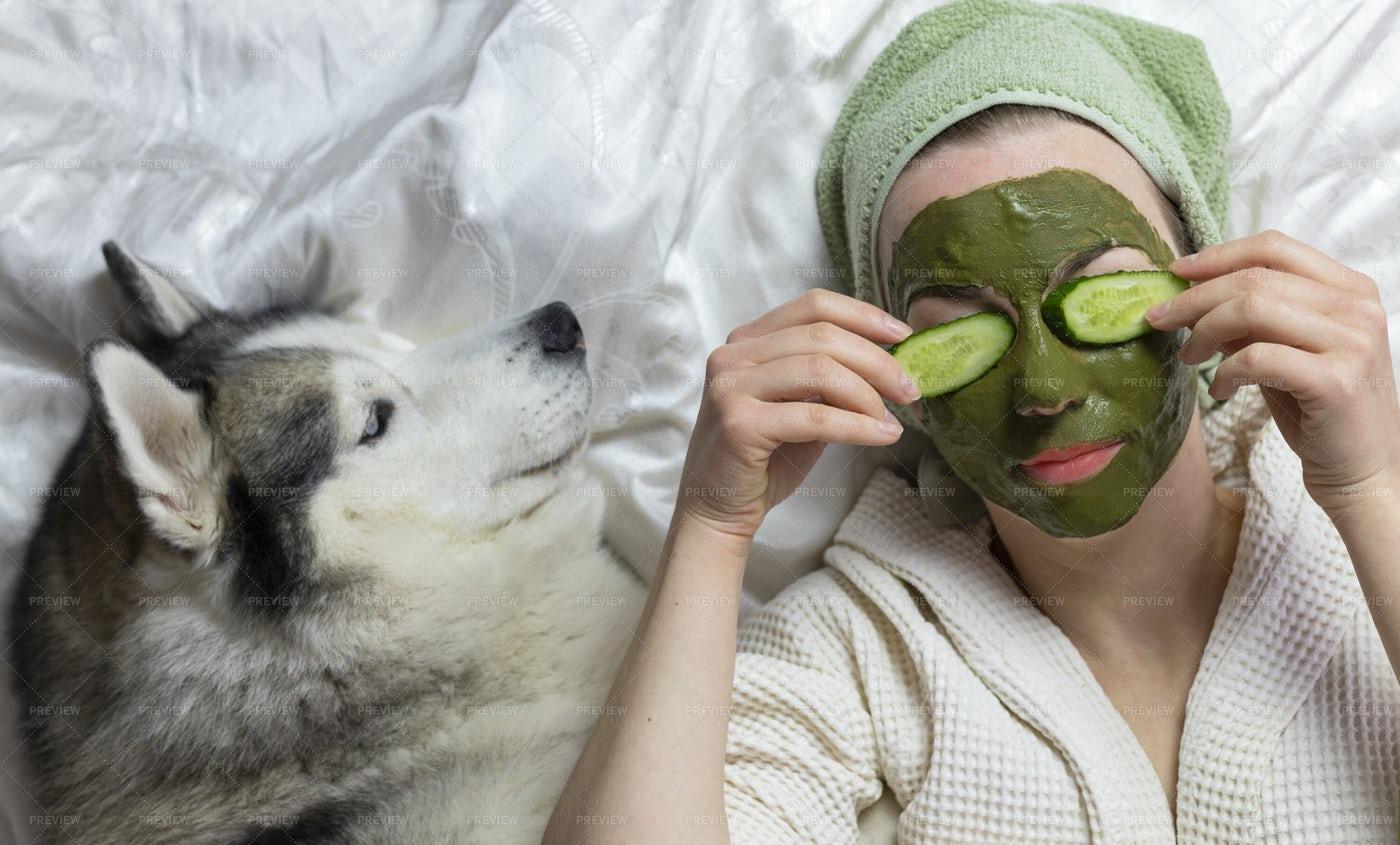 Selfcare Next To Dog: Stock Photos