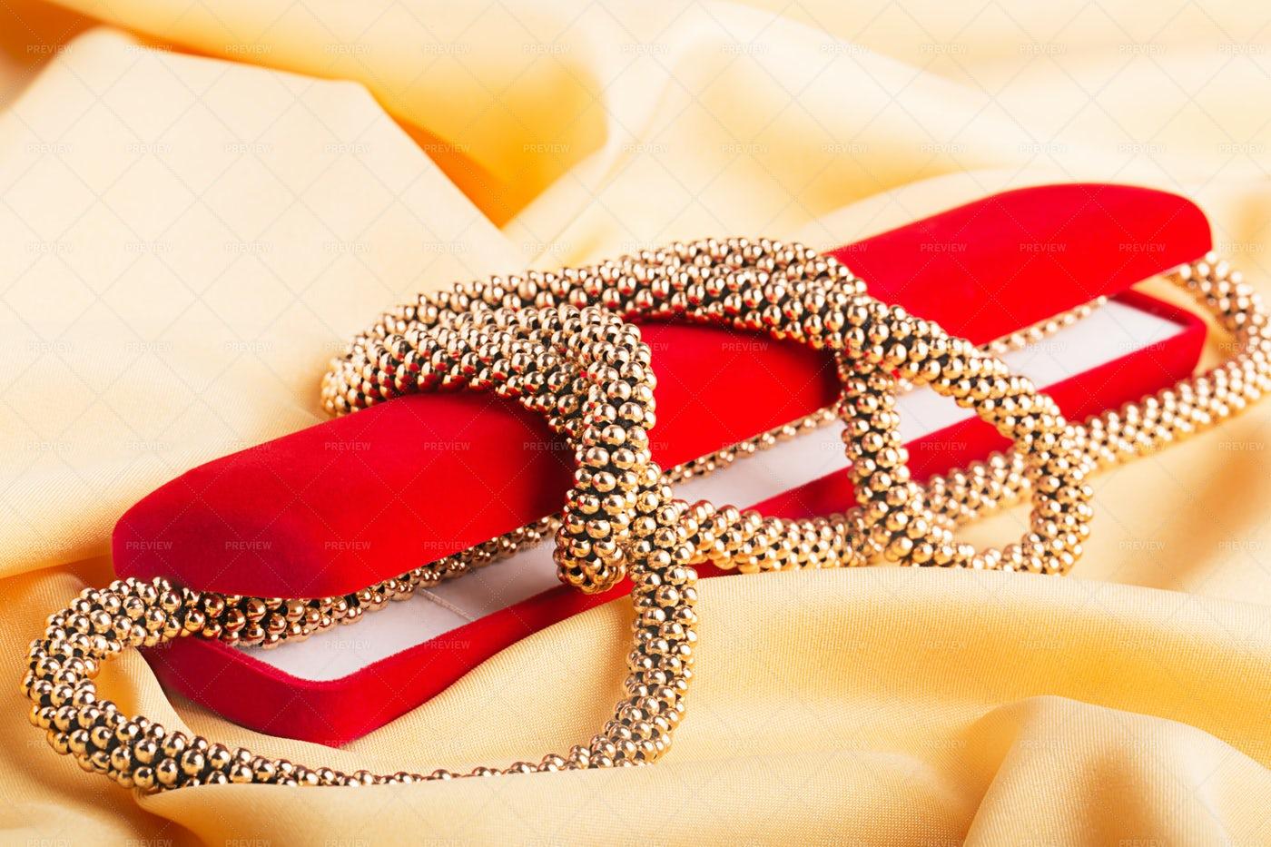 Golden Necklace And Box: Stock Photos