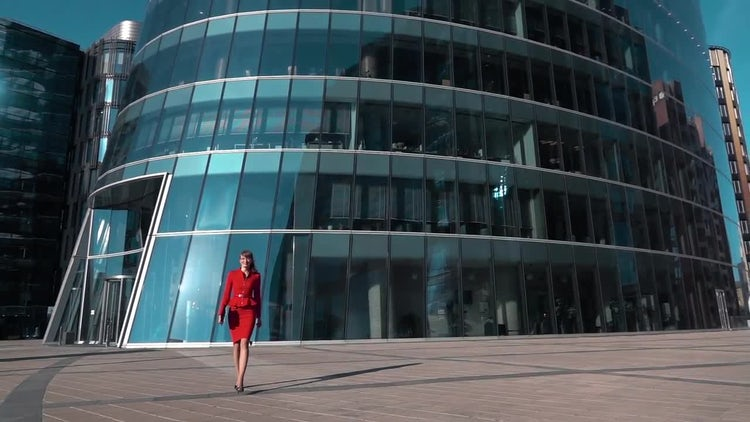 Businesswoman Walking Near Glass Building: Stock Video