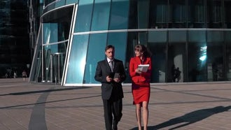 Businesswoman And Businessman Walking: Stock Video