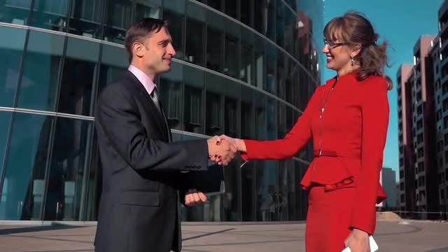 Businessman And Woman Shaking Hands: Stock Video