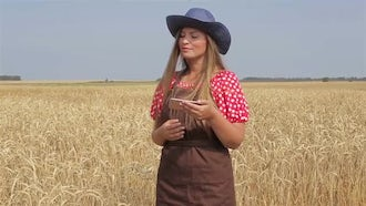 Farm Girl Using Smartphone: Stock Video