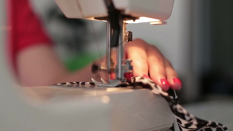 Female Hands Use Sewing Machine: Stock Video