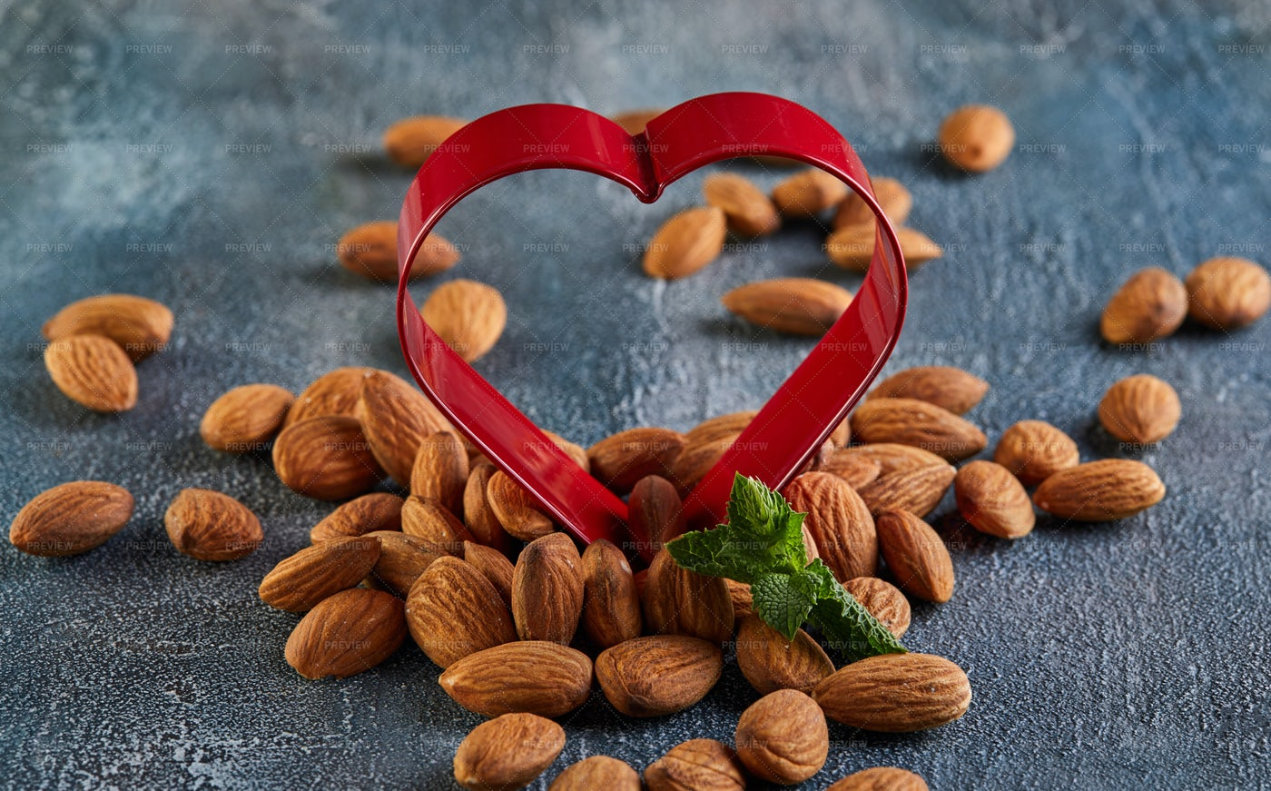 Almonds And A Red Heart: Stock Photos