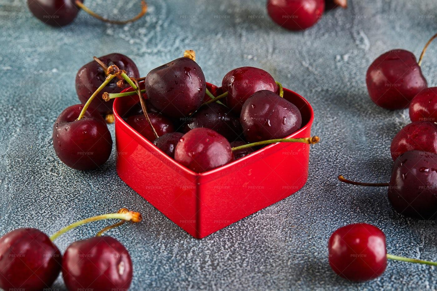 Heart Tin Of Cherries: Stock Photos