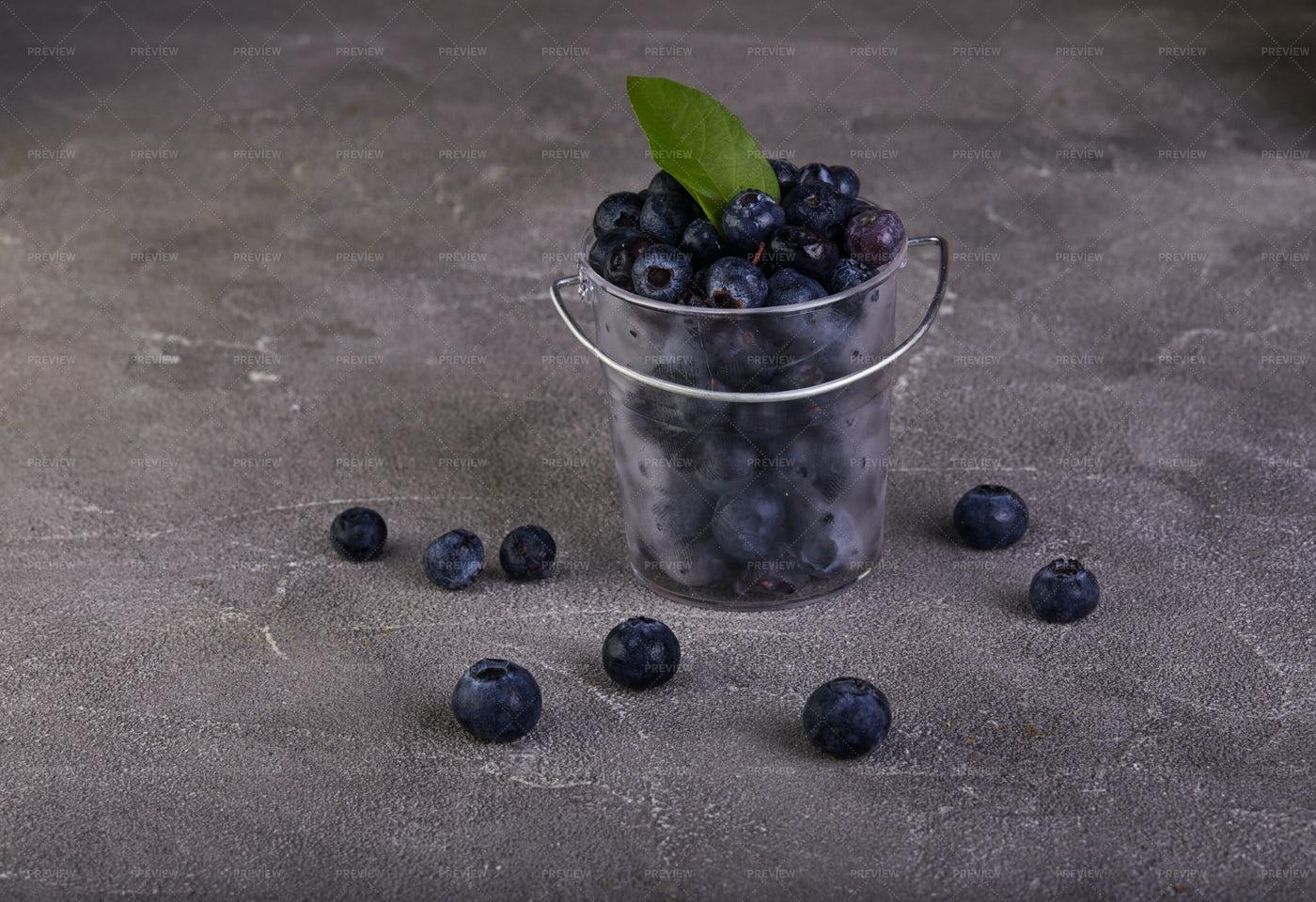 Blueberries In Transparent Bucket: Stock Photos