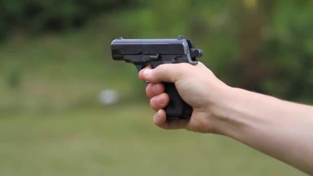 Man Firing A Gun: Stock Video