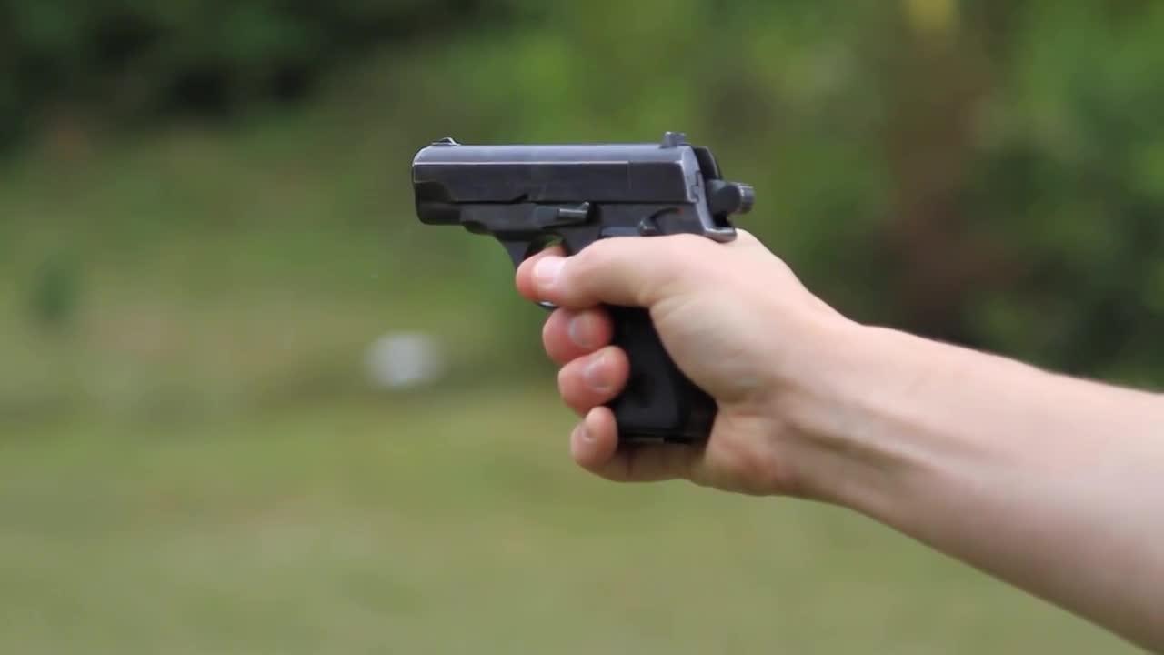 Man firing a gun stock video motion array