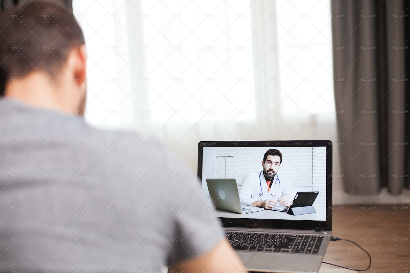 Video Call With His Doctor: Stock Photos