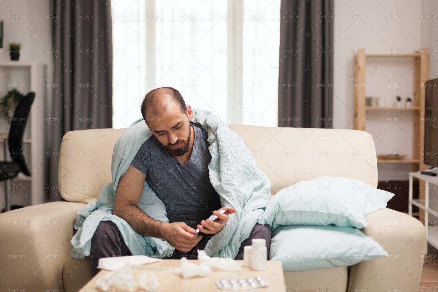 Sick Man Checking His Pills: Stock Photos