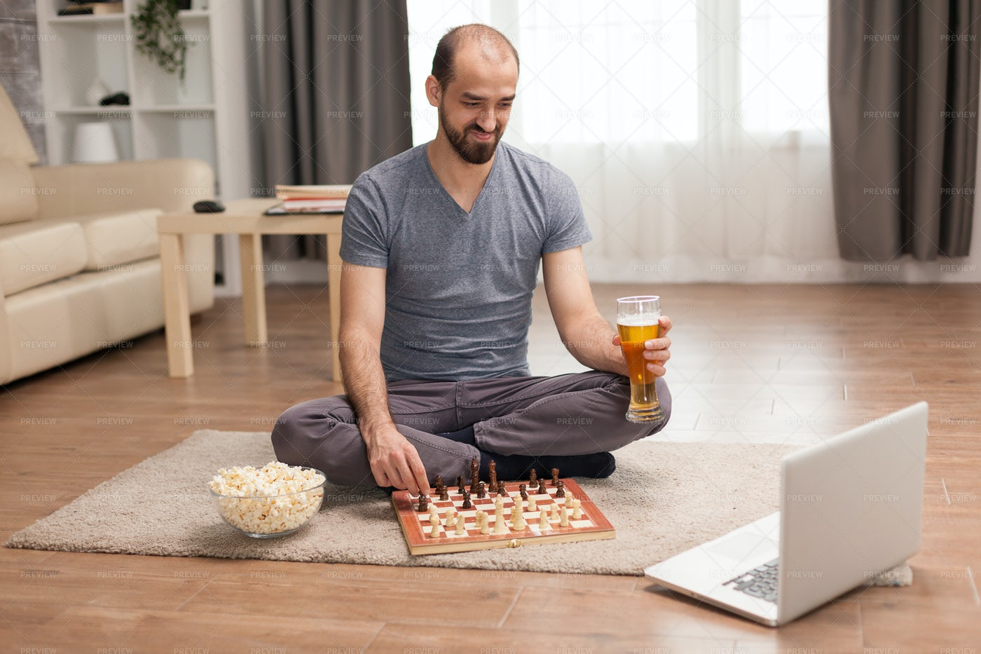 Smiling While Playing Chess: Stock Photos