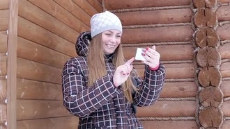 Woman On Video Call While Snowing: Stock Video