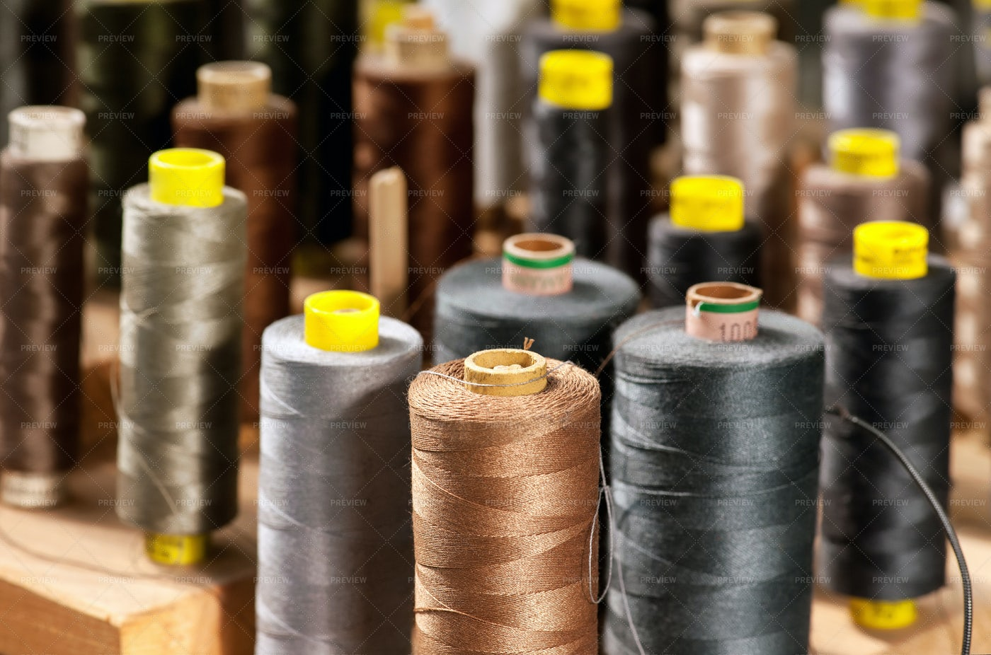 Colored Yarn On Bobbins: Stock Photos