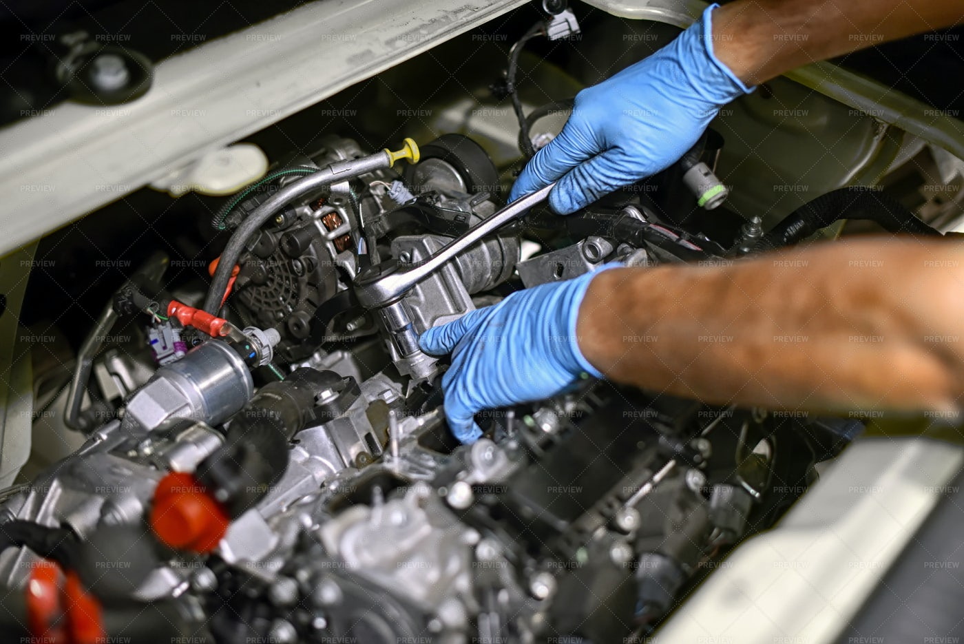 Mechanic Works On An Engine: Stock Photos