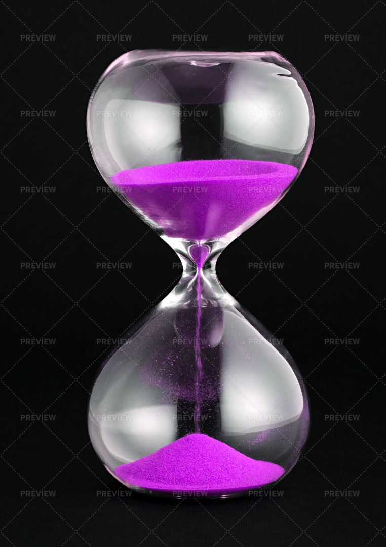 Hourglass With Purple Sand: Stock Photos
