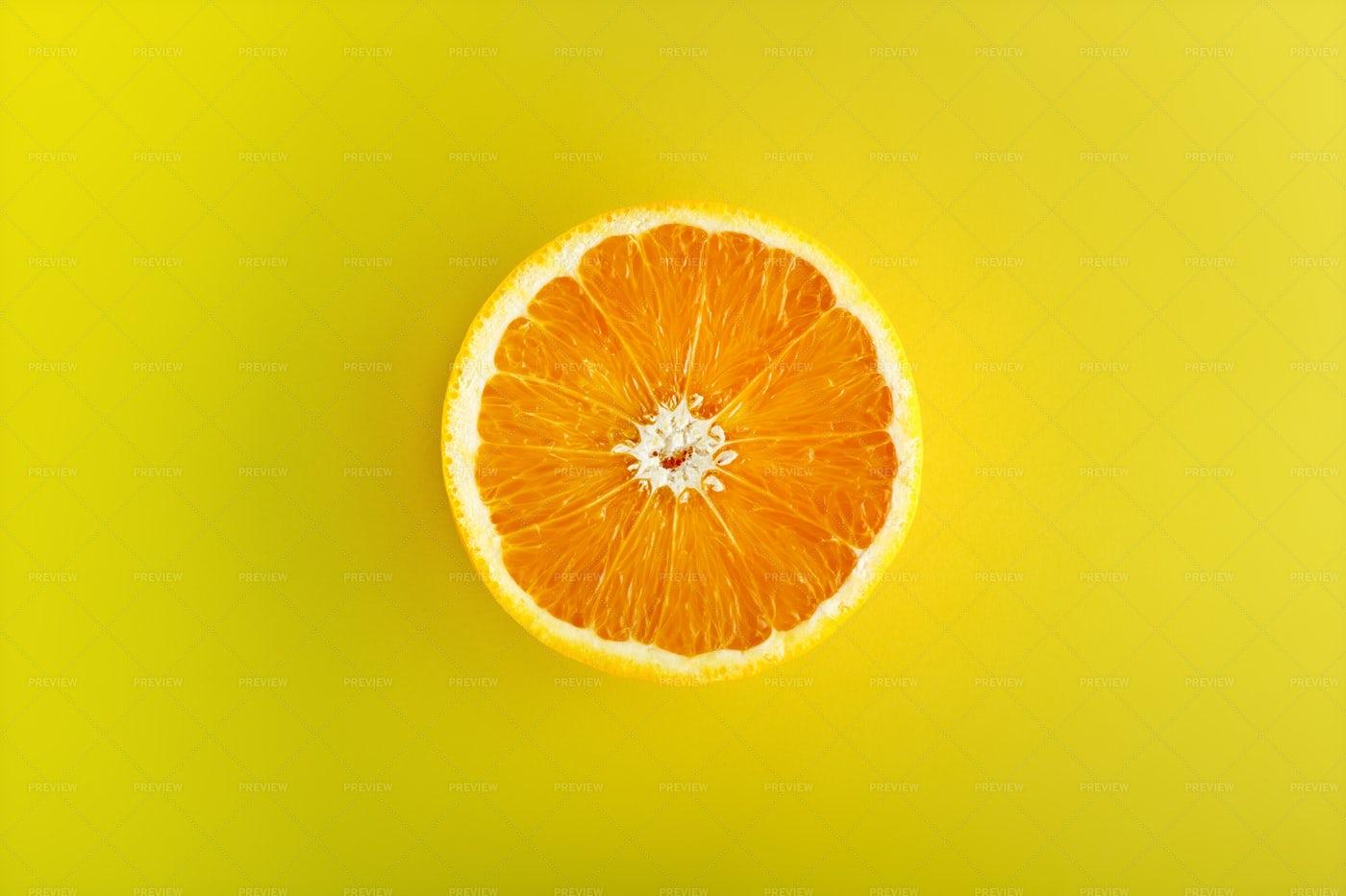 Orange Half On Yellow: Stock Photos