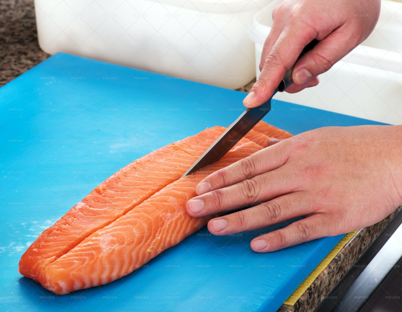 Chef Slicing Raw Salmon: Stock Photos