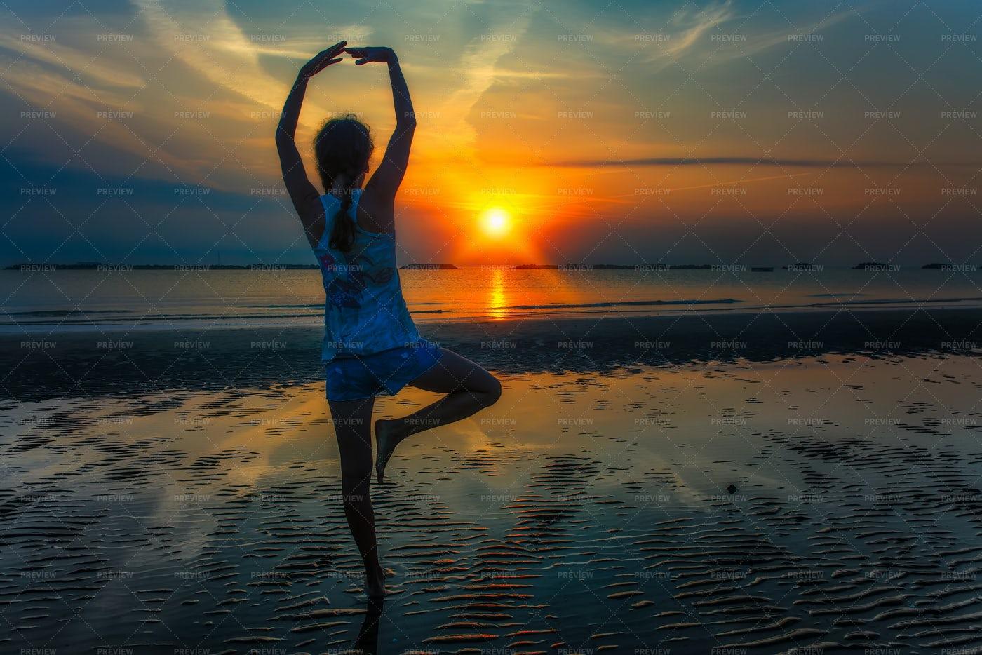 Sun Salutation At Sunrise: Stock Photos