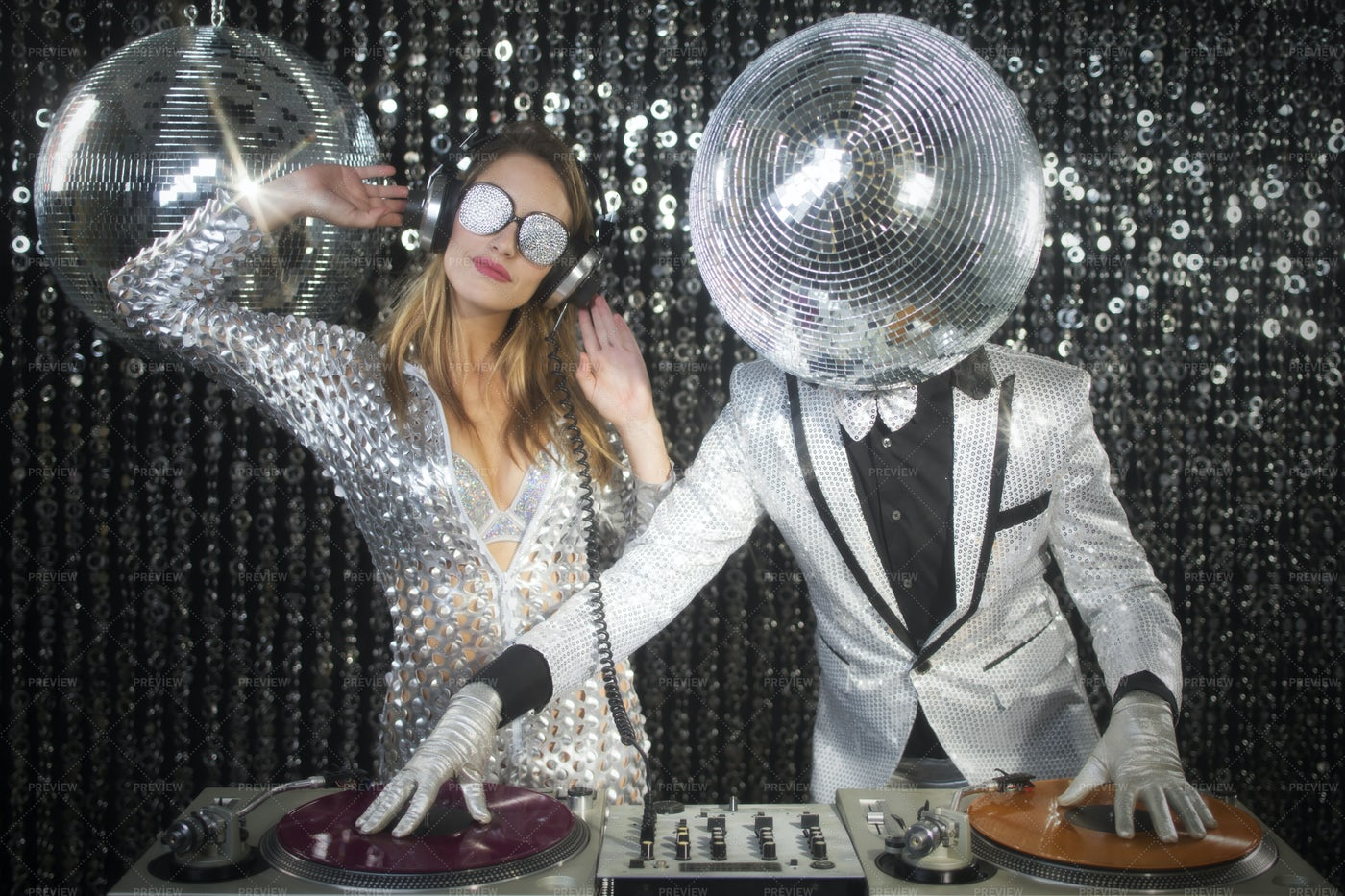Mr And Mrs Discoball DJing: Stock Photos