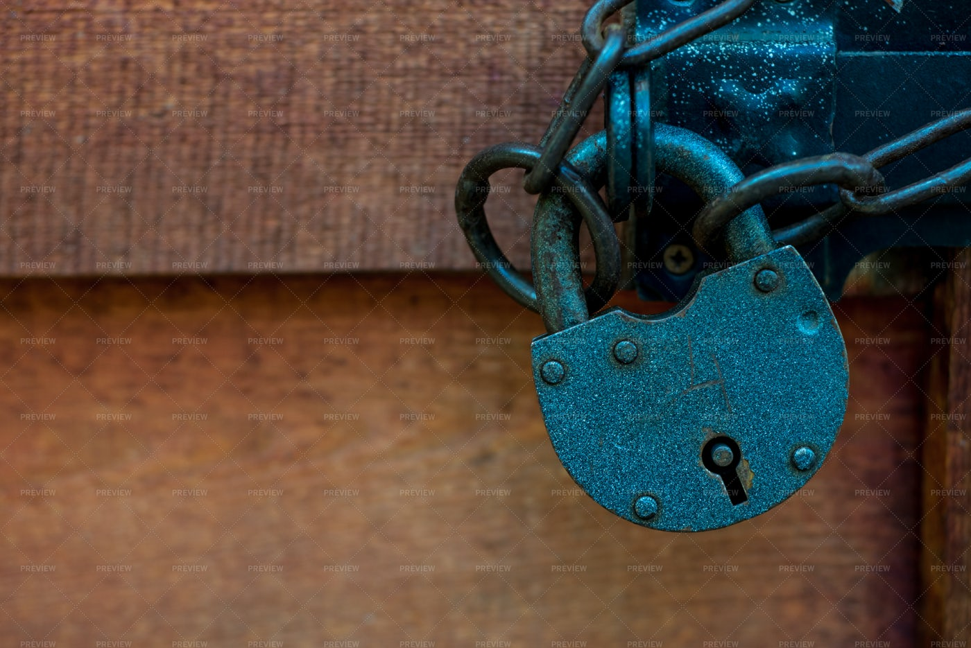 Padlock On A Wooden Door: Stock Photos