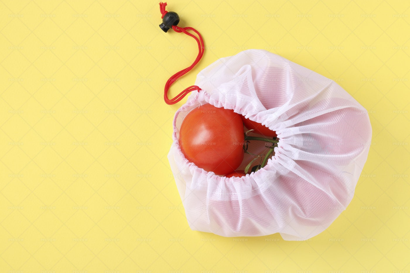 Tomatoes In Mesh Bag: Stock Photos