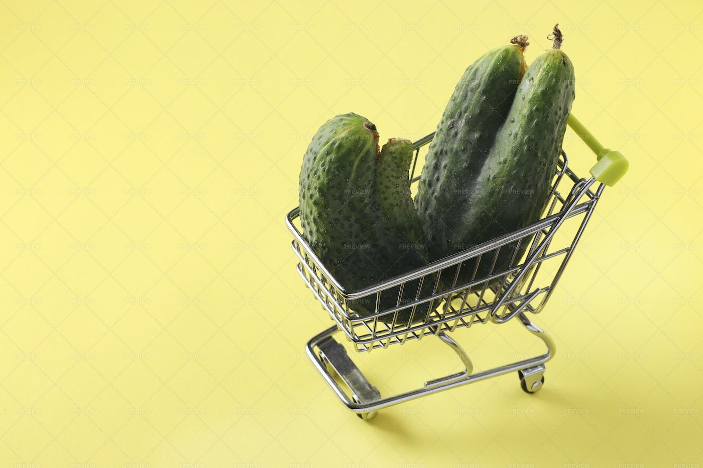 Grocery Trolley Cucumbers: Stock Photos
