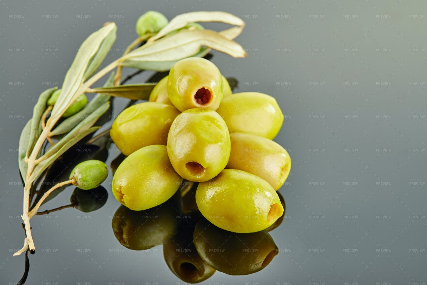 Olives With A Branch Of An Olive Tree: Stock Photos