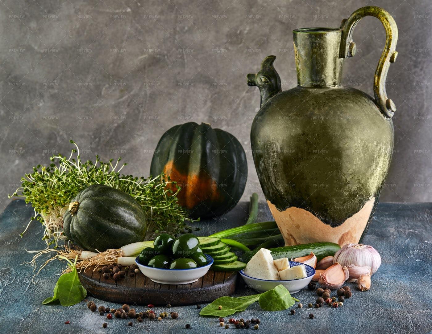 Big Jug Beside Vegetables: Stock Photos