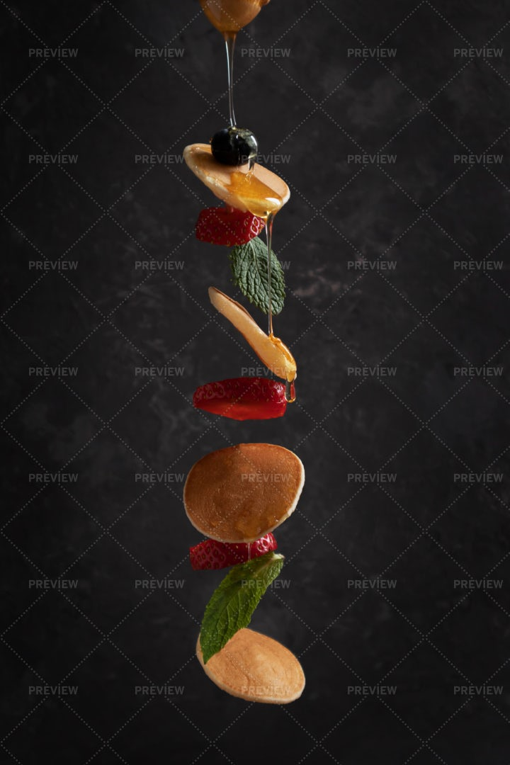 Tiny Pancakes With Berries In Flight: Stock Photos