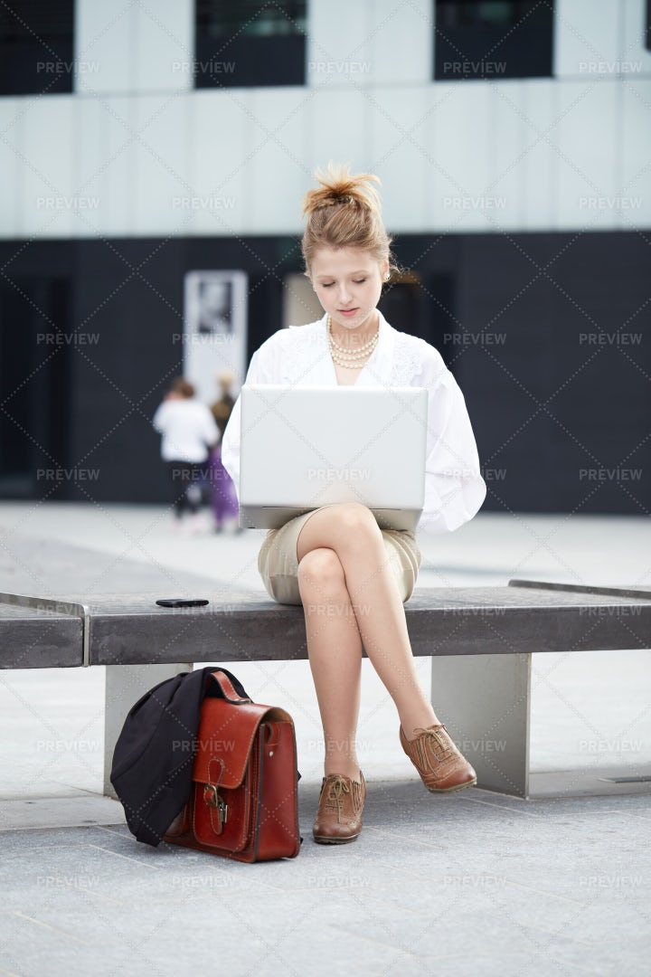 Working On Laptop: Stock Photos