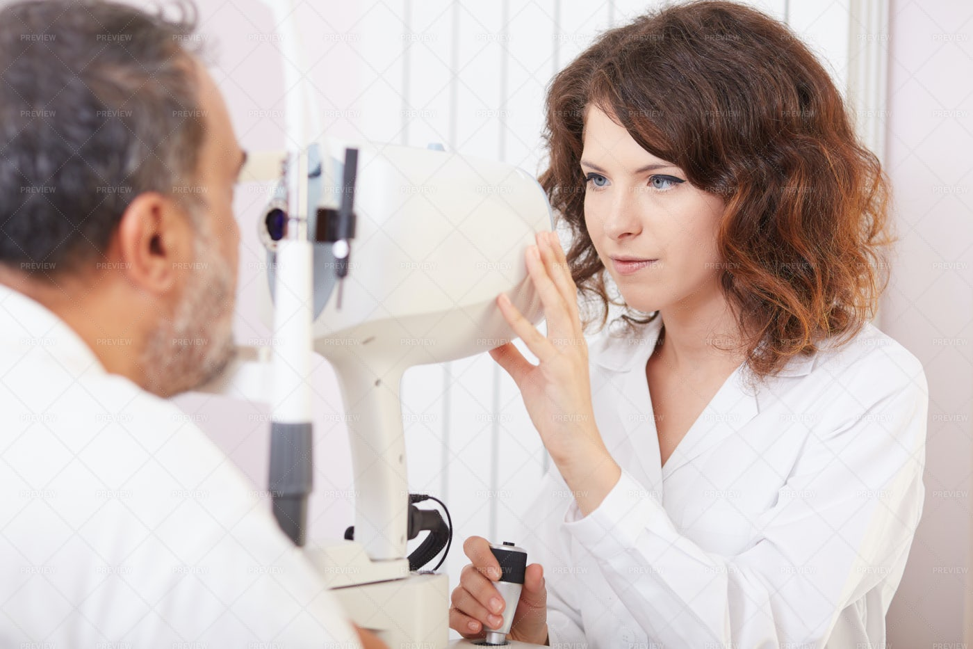 A Female Ophthalmologist: Stock Photos