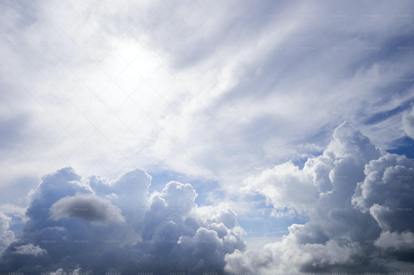 Sun Behind The Clouds: Stock Photos